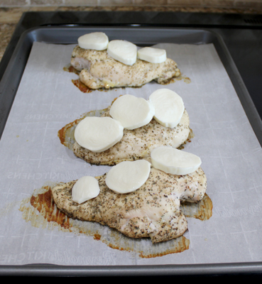Add mozzarella to the cooked chicken breasts