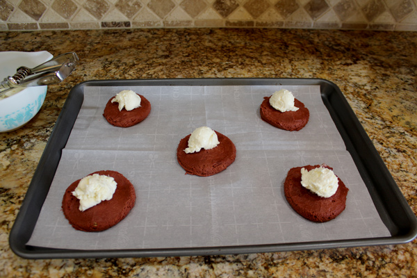 Add the frosting onto the flattened cookie dough