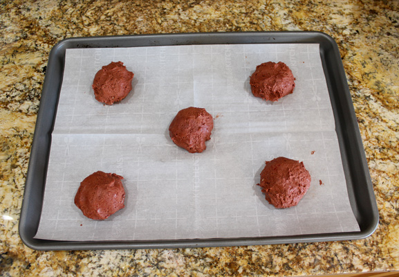 Roll the dough back into a ball with the frosting inside