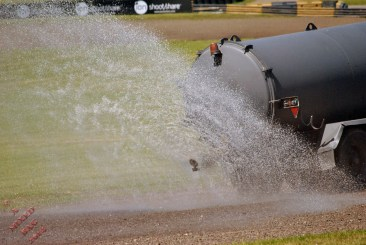 Wetting the ground to damp the dust