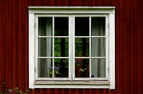 Peering into my childhood summerhouse for the first time in 25 years. Photo by Julian Bowers.  Ulriksdal, Mässvik, Sweden, July 2009.