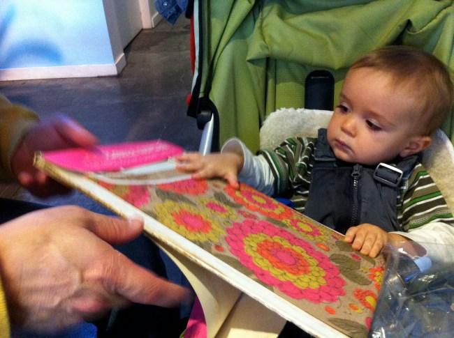 My nephew Henrik helps unpack my vintage paper dress, January 2013