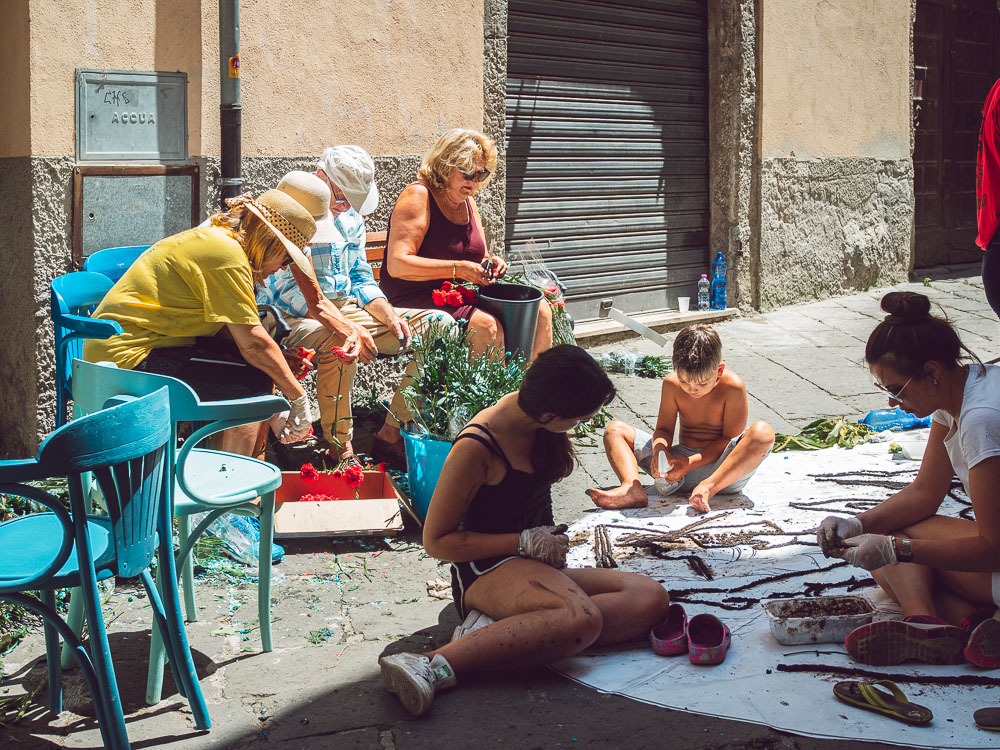 people working at the infiorata in bolsena