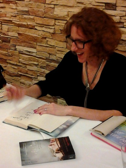 Gayle Forman, author of LEAVE ME,, signs copies of her books. Photos by Shelley Widhalm/Shell's Ink Services.