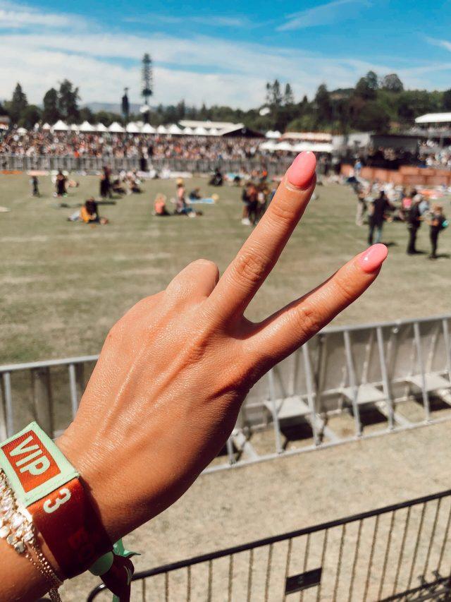 Fashion blogger KatWalksf wears a Bottlerock 2021 VIP pass wristband