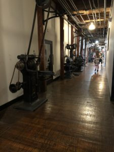 Machinery lining the hallways of the building.