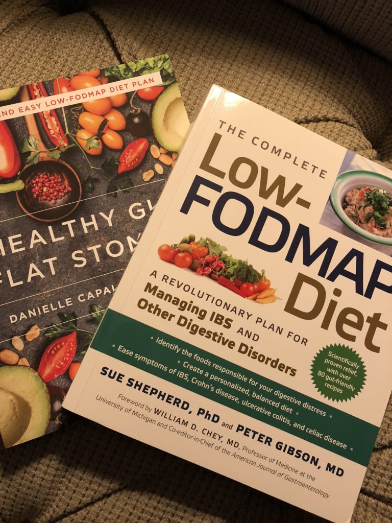 "A picture of 2 books. ""The complete Low-FODMAP Diet"" and ""Healthy Gut, Flat Stomach."""