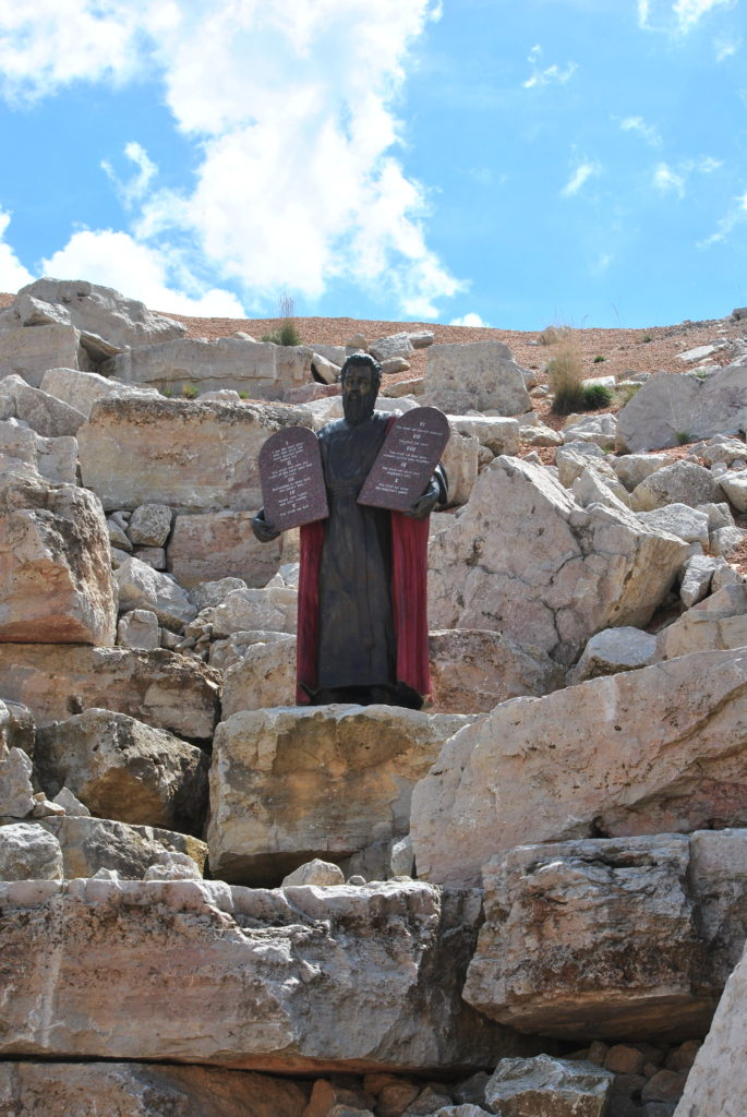 Moses on top of boulders depicting Mt. Sinai.