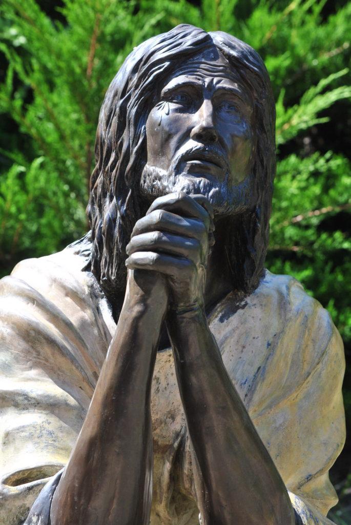 Jesus praying in the garden.