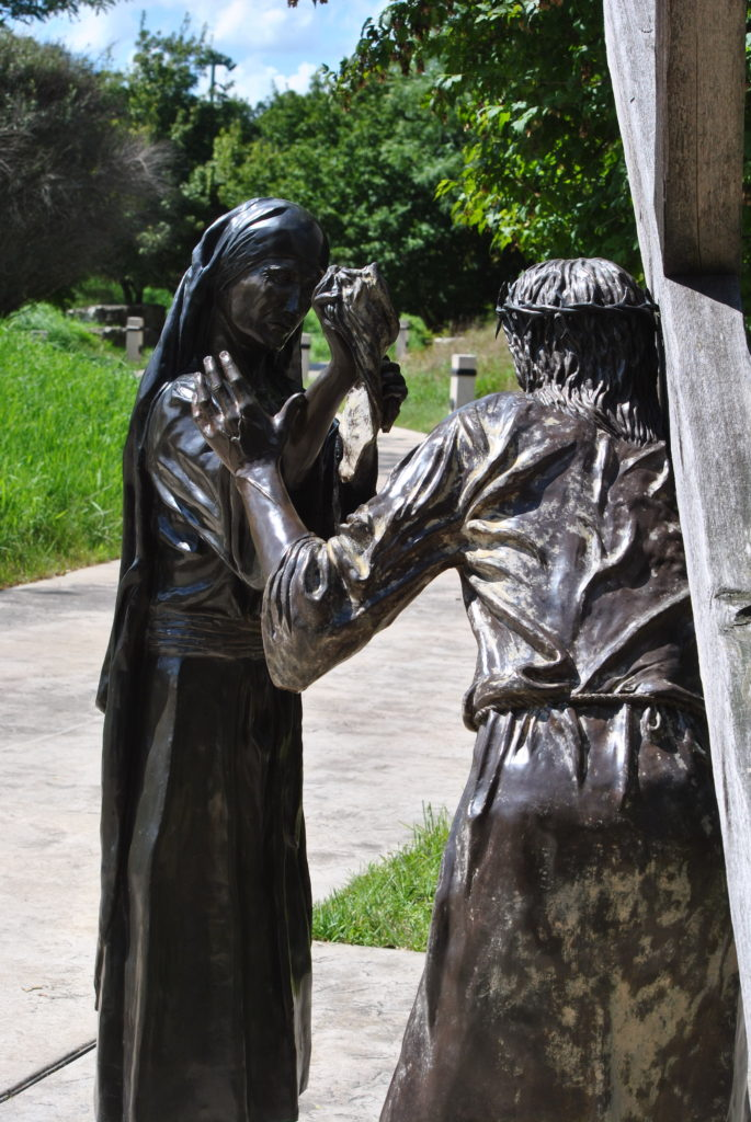 Veronica wipes the sweat from Jesus' face where she sees that His Holy image remained on the cloth.
