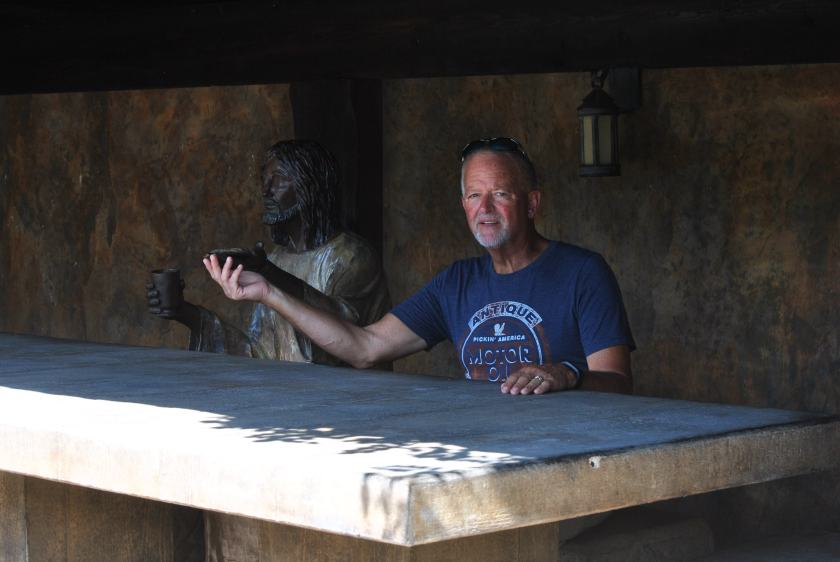 Poo sitting with Jesus at the table of The Last Supper.