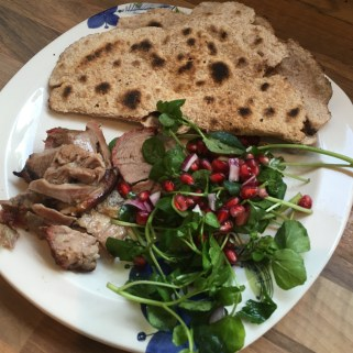 Slow cooked persian lamb, pomegranate salad and homemade flatbreads
