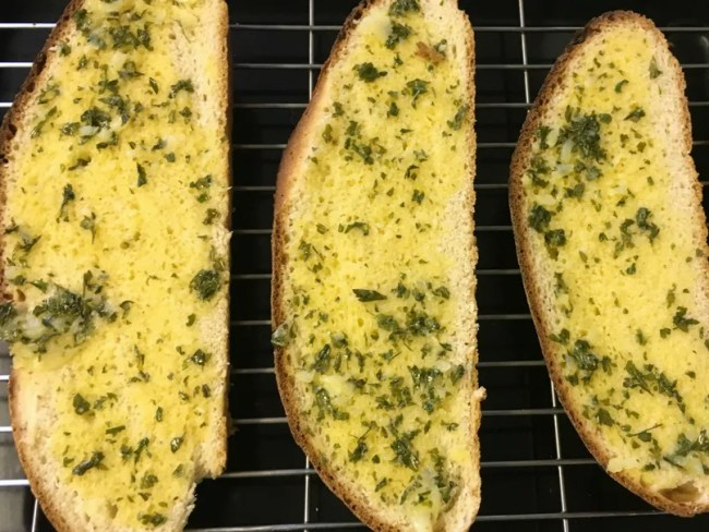 Easy homemade garlic bread - look at the bread once it has been dressed! Delicious