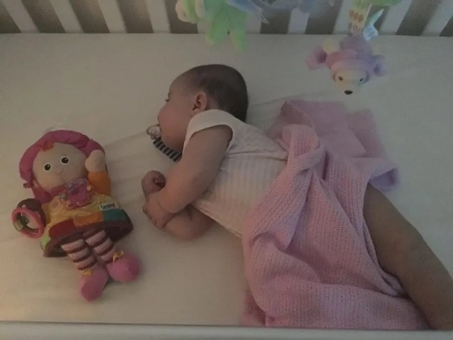 Daisy sleeping in her cot - Global FPIES Day