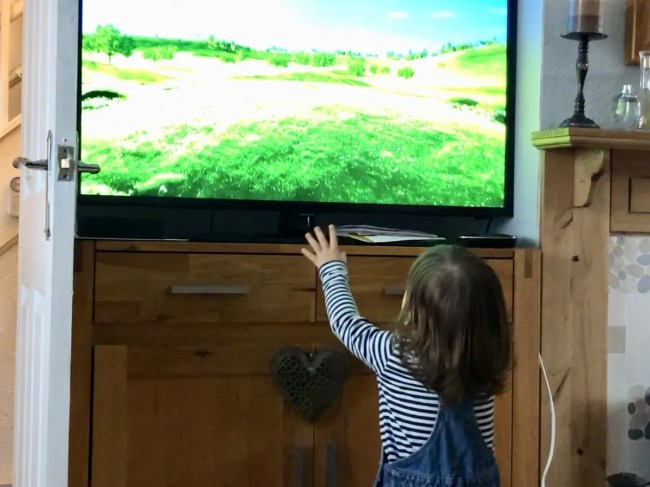 Living Arrows 10/53 - Daisy pointing at the television at Grandma's house