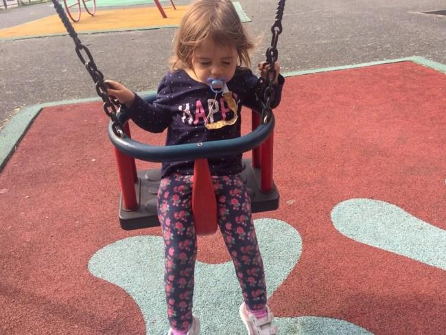 Living Arrows 38/53 - Daisy asleep in a swing
