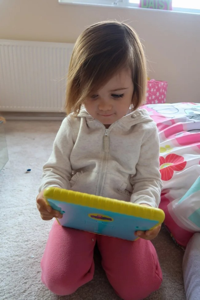Daisy playing on her Peppa Pig Smart Tablet