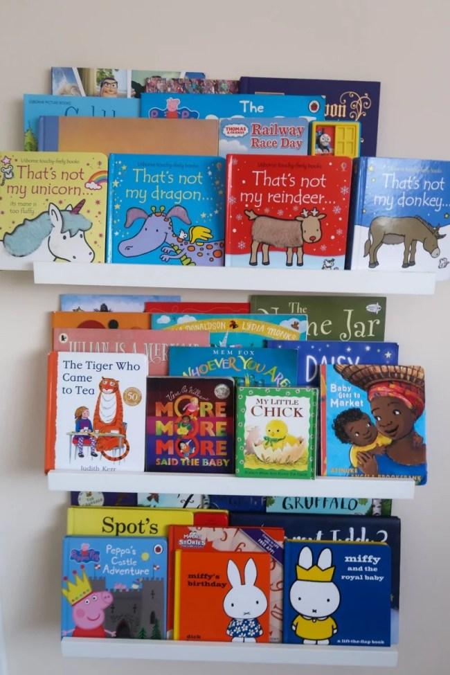 Three bookshelves full of children's books
