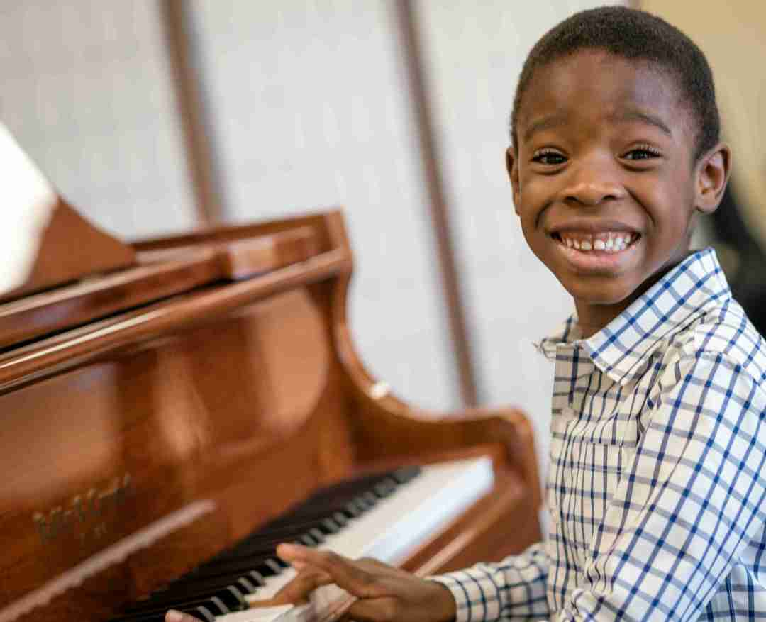 Young boy taking piano lessons at The Conservatory of Music at North Katy