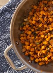 closeup sweet potato hash in pan