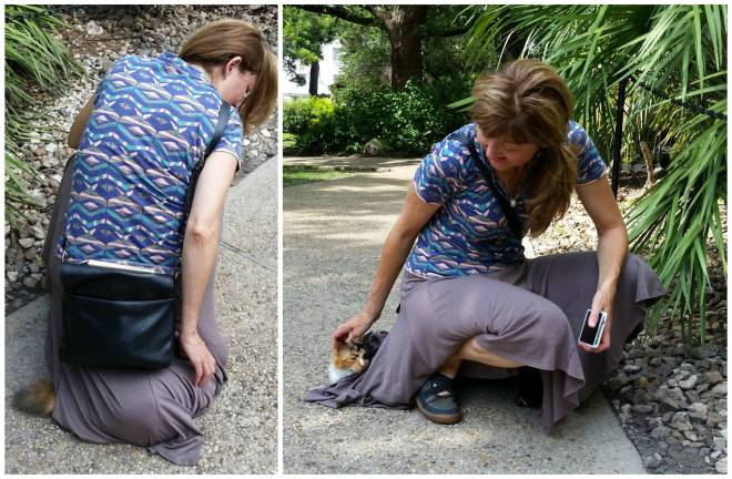 Woman petting cat