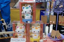 A trio of colorful solar powered waving cats