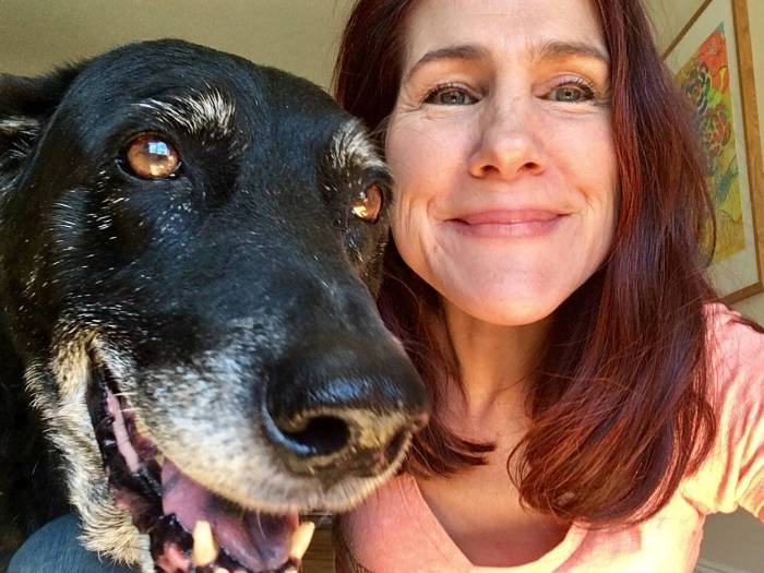 My dog and me, each of us happy and healthy.