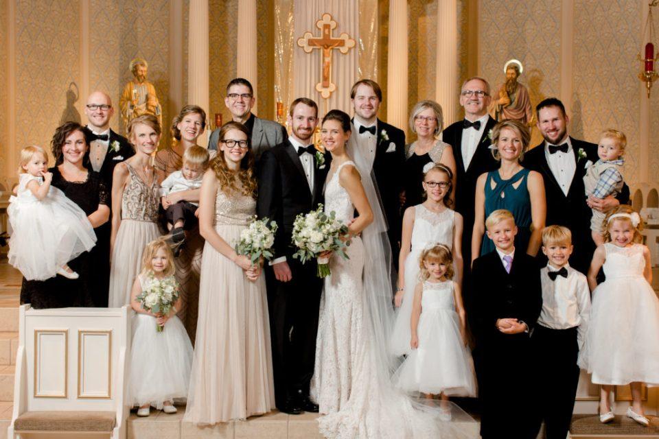 Family formal portrait in catholic church
