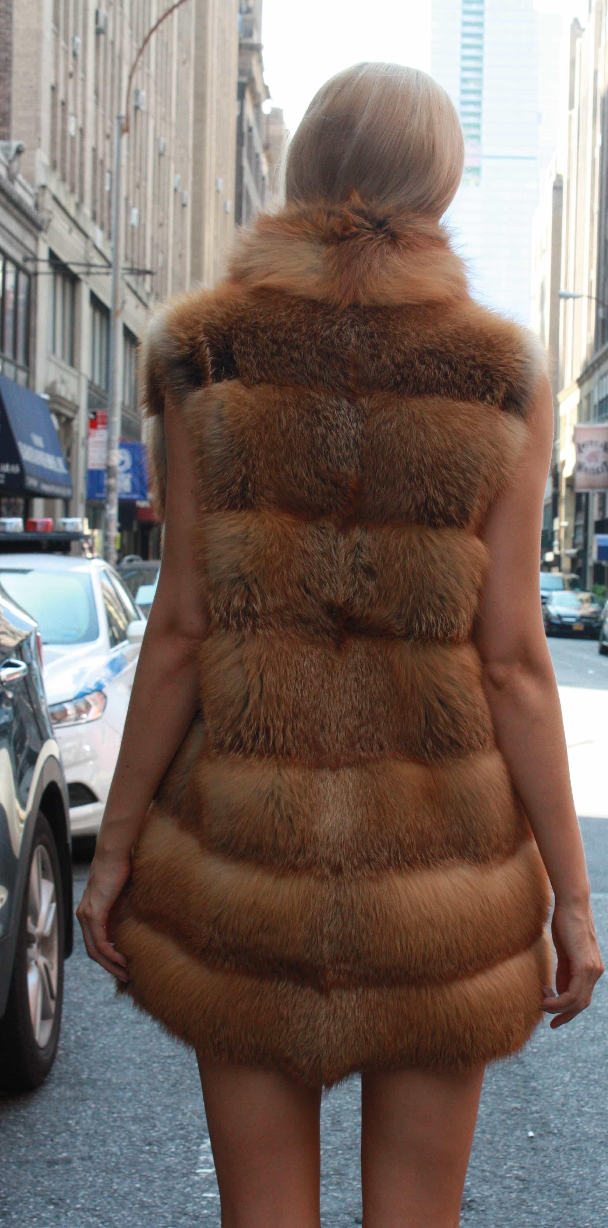 Marc Kaufman Furs Presents a red fox fur horizontal vest from Marc Kaufman Furs New York,Argentina,United Kingdom,Austria,Denmark,Norway,Australia,Finland,Saudi Arabia,Oman,Kuwait,Jordan,Egypt