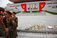 Members of a military band stand by their instruments at the capital's main ceremonial square after a mass rally and parade, in Pyongyang. REUTERS/Damir Sagolj