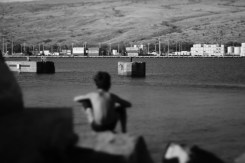 boy at LSD and piers at king tide