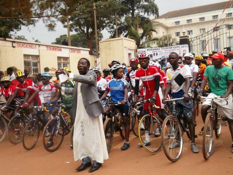 Impeached Uganda Cycling Association (UCA) President, Sam 'Mahaba' Muwonge flags off a Coronation cycling event at Bulange Mengo in Kampala