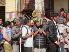 Sherpas waiting for blessings for successful climb.