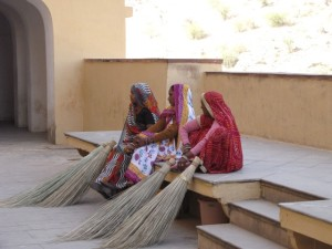 women with brooms