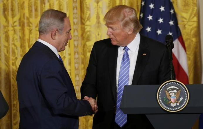 FILE PHOTO: U.S. President Donald Trump (R) greets Israeli Prime Minister Benjamin Netanyahu after a joint news conference at the White House in Washington, U.S., February 15, 2017. REUTERS/Kevin Lamarque