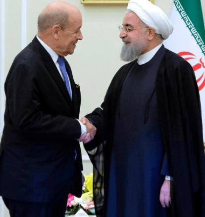 Iranian President Hassan Rouhani shakes hands with French Foreign Affairs Minister Jean-Yves Le Drian, in Tehran, Iran, March 5, 2018