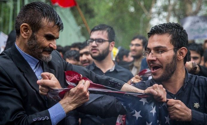 Pro regime basijis around former US Embassy in Tehran ripping the national flag of the United States after President Trump's decision to withdraw from JCPOA, 8 May 2018