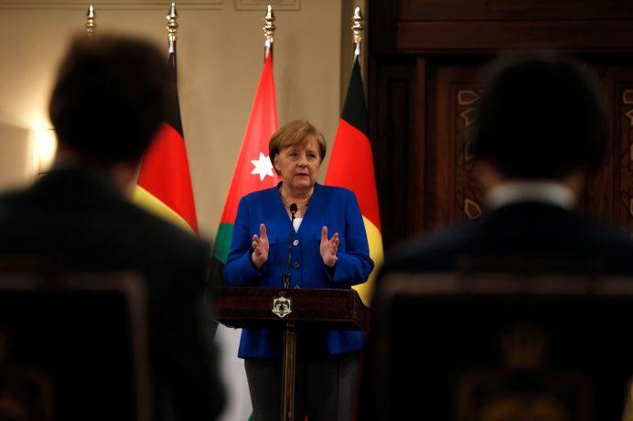 FILE PHOTO: German Chancellor Angela Merkel speaks during a news conference at the Royal Palace in Amman, Jordan June 21, 2018. REUTERS/Muhammad Hamed