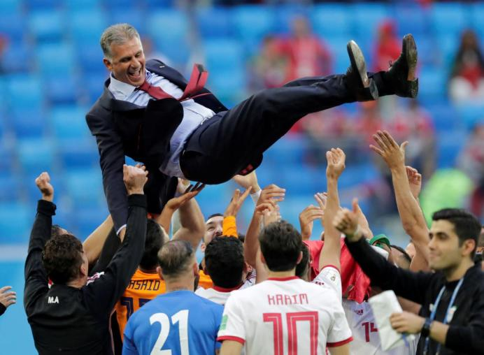 Saint Petersburg Stadium, Saint Petersburg, Russia - June 15, 2018 Iran players lift coach Carlos Queiroz as they celebrate after the match REUTERS/Henry Romero