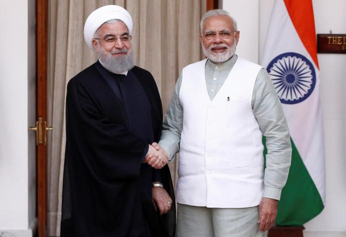 FILE PHOTO: Iranian President Hassan Rouhani shakes hands with India's Prime Minister Narendra Modi (R) during a photo opportunity ahead of their meeting at Hyderabad House in New Delhi, India, February 17, 2018. REUTERS/Adnan Abidi