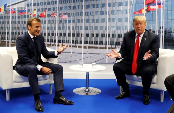 U.S. President Donald Trump meets with French President Emmanuel Macron during the NATO summit in Brussels, Belgium July 11, 2018. REUTERS/Kevin Lamarque