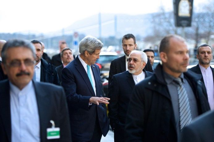 FILE PHOTO: Former U.S. Secretary of State John Kerry and Iranian Foreign Minister Javad Zarif chat as they walk along the Quai des Bergues in Geneva, Switzerland, on January 14, 2015. [State Department photo/ Public Domain]