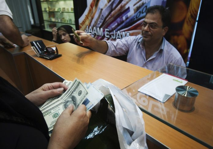 2010-10-03T120000Z_661241154_GM1E6A31LUZ01_RTRMADP_3_IRAN-CURRENCY-RATE