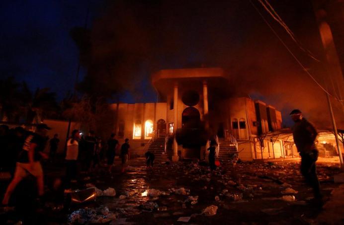Iraqi protesters are seen in front of the burnt Iranian Consulate in Basra, Iraq September 7, 2018. REUTERS/Essam al-Sudani
