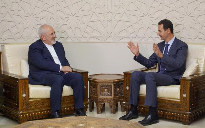 FILE PHOTO: Bashar al-Assad meets with Javad Zarif in Damascus, Syria September 3, 2018. REUTERS