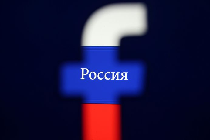 FILE PHOTO: A 3D printed Facebook logo is seen in front of a displayed Russian flag in this photo illustration taken on August 3, 2018. Photo illustration taken August 3, 2018. REUTERS/Dado Ruvic/Illustration