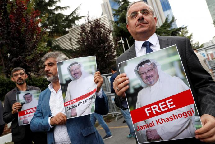 Human rights activists and friends of Saudi journalist Jamal Khashoggi hold his pictures during a protest outside the Saudi Consulate in Istanbul, Turkey October 8, 2018. REUTERS/Murad Sezer