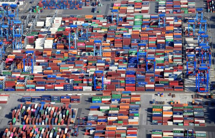 Aerial view of containers at a loading terminal in the port of Hamburg, Germany August 1, 2018. REUTERS/Fabian Bimmer