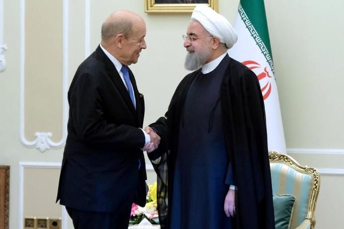 FILE PHOTO: Iranian President Hassan Rouhani shakes hands with French Foreign Affairs Minister Jean-Yves Le Drian, in Tehran, Iran, March 5, 2018. Reuters
