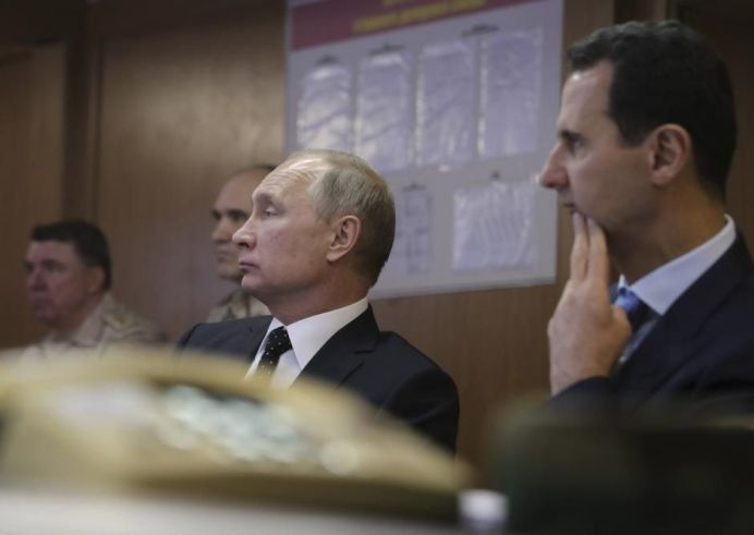 Russian President Vladimir Putin (2nd R) and Syrian President Bashar al-Assad (R) REUTERS